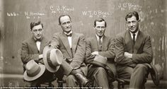 Mob mentality: All four of these men, pictured in 1921, are wearing sharp suits and carrying hats for their mugshot