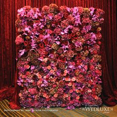 flower backdrop. If your budget does not go this far make paper flowers with your bridesmaids and family.