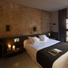 rustic stone wall bedroom