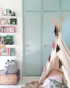 For the new kids room! Mint green wardrobe book shelves display and a cute teepee for kids! What's not to love?