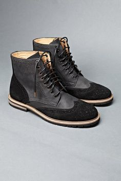 Black Suede/Goat Leather wingtip boot with oil finish. Worker last, mixed rubber and leather sole.
