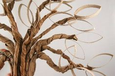 so cool! tree made from paper bags and paper rolls!
