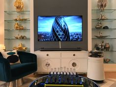 An artful living room. This Jonathan Adler designed space features the LG Signature OLED Smart TV and All in One Air Purifier & Humidifier.