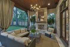 This backyard porch is amazing!!