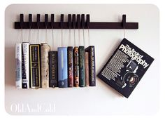 OldAndCold _Custom made wooden book rack in Wenge. Movable pins.The pins also work as bookmarks.