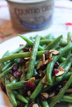 Green Beans with Cranberries and Almonds - I'd use butter, myself.  :)