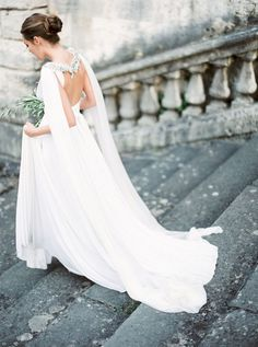 Elegant wedding gown with embellished cape by Gibson Bespoke + Styling by Comme Soie | Destination film wedding photographer Peaches & Mint