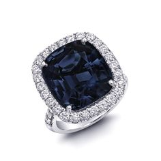 An engagement ring set with a Natural Blue cushion cut Spinel 14.27 carats set in Platinum Ring with a Diamond halo / Jupitergem