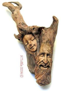 """""""Tree for Two""""   This happy couple measures 16 inches tall and   approximately 9½ inches across his widest point.  They're carved into a single piece of beautiful driftwood.   Signed and dated:  N. Tuttle 3/23/14"""