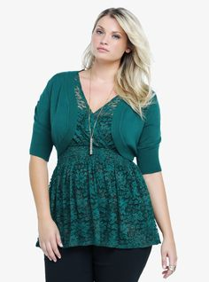 Our infatuation with lace continues with this sexy emerald green shrug. With a sheer floral lace back, it slips over just about anything for a stunning finish. Ribbed trim hem and sleeves.