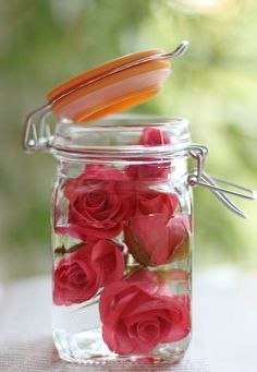 Unique idea, red roses in mason jar. Maybe silk flowers will work