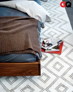 GQ mag - Area rug under your bed: no more ice-cold morning foot, no more tracking floor gunk into the sheets. But it's also a subtle style play that anchors the room's new hunkered-down vibe. Look for a rug with a geometric pattern, and don't worry about a design being over the top—most   of it will be hidden under the bed.  Berber rug by The Rug Company, $4,104.