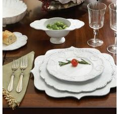 The Bella Bianca collection is crafted using a delicate white glaze over a rich, black clay. The patterns were exquisitely designed by an Italian fashion designer using details found in fabrics and accessories. The scalloped edges, antique lace, beading, emblems and subtle floral motifs all combine to create this elegant, unique tablesetting.  #dinnerware #tableware #italian  www.theitaliandish.com