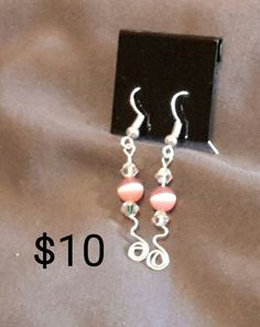 Pink cats eye beads with clear Swarovski crystal silver spiral earrings.