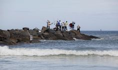At the north end of New Smyrna Beach, near the inlet, a man-made rock pier attracts fishermen. GOING! New Smyrna Beach Florida, Florida Vacation, Florida Beaches, Community Art, Palm Beach, Surfing, Fishing, River, Rock