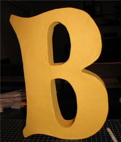 DIY papermache letter-OH MY GOODNES I READ THE TUTORIAL & SO EASY...  I SERIOUSLY AM GOING TO TRY THIS & POST IN MY LOOK WHAT I CAN DO FOLDER.  JUST FINISHED THAT RULER & I NEED TO POST IT!  BUT HECK YEAH, YOU CAN DO THIS PEOPLE!