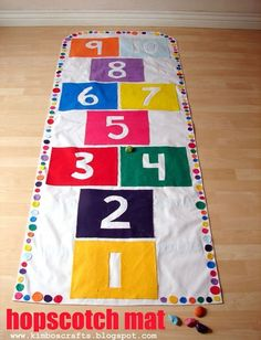 Are you looking for something to add to your Easter basket that isn't made of sugar?  A chocolate bunny and a few jelly beans is all well and good but check out this simple hopscotch mat.  It's easier to make than you think, even if you're short on crafting skills.