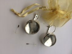 HURRY! BIGGEST SALE OF THE SEASON  For 20% USE COUPON CODE:  BIGGESTSALE20  (MINIMUM PURCHASE £6)  Handmade Item * Material: Real Dandelion Seeds Cabochon Earrings in Resin. The Earrings are nickel and lead free.  * Size: 20mm(0.78 inch) Light Silver Plated French Lever Back Earrings These Adorable and Gorgeous Dandelion earrings Will Make You Stand Out From The Crowd!  Pretty Dandelion Seeds Floating in Resin Where you have the power to freeze forever in time! A Fabulous Treat For Yourself…