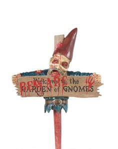 """Zombie Gnome Sign exclusively at Spirit Halloween - Give fair warning to trespassers on Halloween and everyday thereafter, when you decorate your lawn or garden with this Zombie Gnome Sign. This 18"""" sign warns neighbors of the terrors that await them if they wander too far over the fence. He can be yours for $39.99."""
