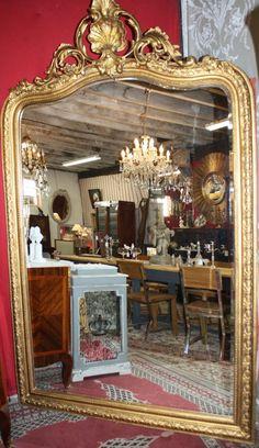 Glace / miroir style Louis XV doré
