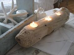 Great DIY Driftwood Tealight Candleholder. Use a hole saw bit to create the holes for your tealights to sit into.
