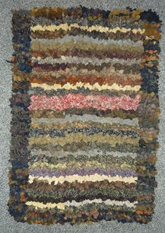 Shaker Rag Rug This sophisticated piece has a crocheted backing, typical of the Shakers, through which the wool strips are worked.