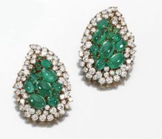 JEWELS FROM THE COLLECTION OF LILY MARINHO - Pair of emerald and diamond ear clips - Each of paisley design, set with cabochon emeralds and brilliant-cut diamonds, mounted in yellow gold, French assay and maker's marks.