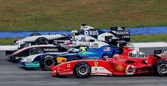 Four abreast - Michael Schumacher (Ferrari), Felipe Massa (Sauber), Juan Pablo Montoya (McLaren) and Nick Heidfeld (Williams)