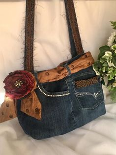 Denim Bag, Upcycled Denim Jeans Bag, Boho Denim Bag... OOAK! Blue denim jeans recycled into a fun, fabulous shoulder bag! Recycyled denim & fabrics take on new life with this classy shoulder bag. This one of a kind purse sports a Wacky Wose rose brooch, bronze scarf, rhinestones, fringe