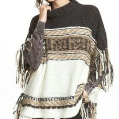 Free People fringed sweater poncho Sz M, oversized silhouette. NWT. Charcoal,  tan and cream make up the colors. Acrylic,  wool and angora rabbit blend...very soft and luxurious feel. Has armholes. **REDUCED FROM $100** Free People Sweaters Shrugs & Ponchos
