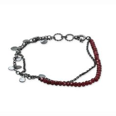 This delicate and edgy Leaf bracelet is made in oxidised silver with deep red garnets. It delicately adds a pop of colour to any outfit