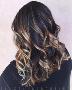 dark brown hair with gold, platinum, and light brown highlights.