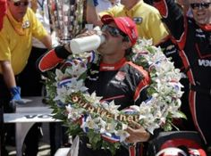 Juan Pablo Montoya celebrates after winning the 99th running of the Indianapolis 500. (AP)