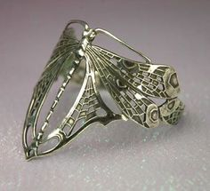 Stunning dragonfly ring in Art Nouveau styling.