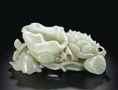 A Large Celadon Jade 'Lotus Flower' Washer. Qing Dynasty, Qianlong Period