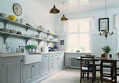 Country style open kitchen shelving.