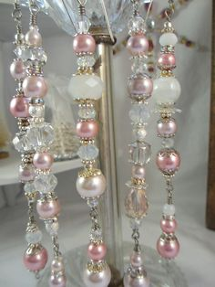 I love this set..Pink is my favorite Christmas color...Scrumptious glass coated pink pears, sparkling crystals..Beautiful glowing silver plated bead caps and spacers...Yummy!!    There are 6 beautiful dangles in this set. Remember...They are not just for Christmas. They make fantastic lighting accents. This set measures about 5 inches. Hangers are included.    All of my dangles and snowflakes are made with glass and crystal beads by hand by me....I use Gold and silver plated bead caps as…