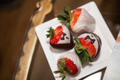 tuxedo and wedding dress bride and groom chocolate covered strawberries that our hotel left us for our big day In-Lace Photography