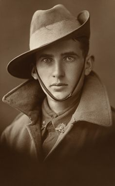 Asti Studio. 'Studio portrait of an unidentified First World War soldier in Australian service uniform, including greatcoat and slouch hat' c.1914 – 1918