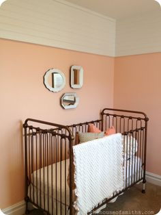love the planked walls above. vintage baby nursery - peach gold and white - brass crib