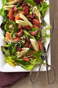 Slices of green kiwifruit, sections of ruby red grapefruit and fresh-tasting fennel--this fruit salad is bursting with flavor and gorgeous color. The crumbled bacon on top provides a pleaseant, savory taste that really compliments the sweet fruit. #salads #saladrecipes #healthysalads #saladideas #healthyrecipes