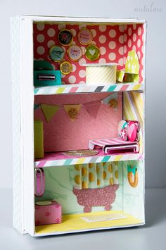 mini dollhouse in a cell phone box.  Surprise travel toy for the kids?