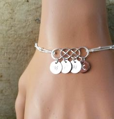 PERSONALIZED INITIAL Please note for me when you check out (A-Z). This sterling silver DOUBLE infinity bracelet, is made with hand stamped 9mm initial disc charms The sterling silver version is 100% sterling silver, and is nickel free. ALL MERTARIAL IS STERLING SILVER. DOUBLE INFINITY 9MM DISC SATELLITE CHAIN All items come wrapped individually in a ribboned gift box.