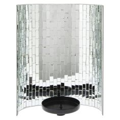 This mosaic candle holder will create beautiful light