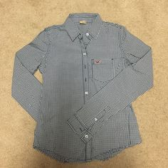 Hollister shirt Never wear because it is too tight for me. Would fit a skinny body. Size is XS Hollister Tops Button Down Shirts