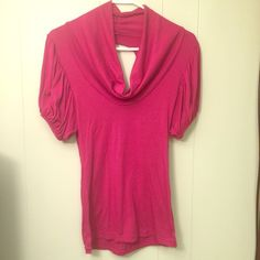 Pink Shirt Item: Pink Shirt  Features: - Cute sleeves  -  Cut out back  Condition: Like new  Price: Negotiable   Reason for Selling: Never wear Tops