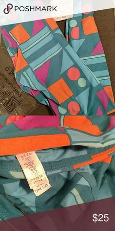 Lularoe Leggings Brand new OS Lularoe Leggings, never tried on.  Blueish/green background with different colored shapes.  Made in China  No trades at this time.    Please note I can only ship on Monday, Tuesday and Wednesdays LuLaRoe Pants Leggings