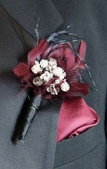Crystal boutonniere with feather accents and wribbon wrapped handle. $8.00, via Etsy.