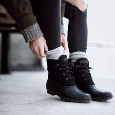 Black on black duck boots. More