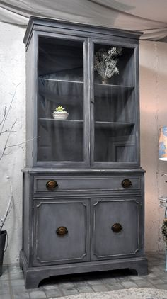This is the exact same cabinet I have that belonged to my grandmother. It is a pea green color - should I refinish it???